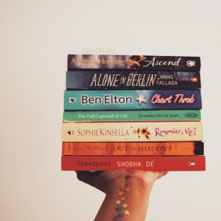 Two birds with one stone: book stack AND holding it out
